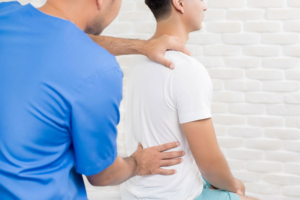 How Chiropractors Relieve Back Pain | Premier Injury Clinics of DFW